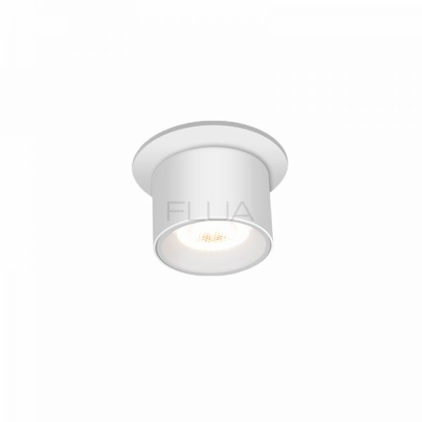 Round shaped small spot fixture on the ceiling.