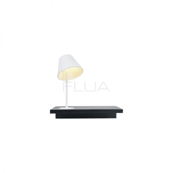 Contemporary white lamp ona dark color table.