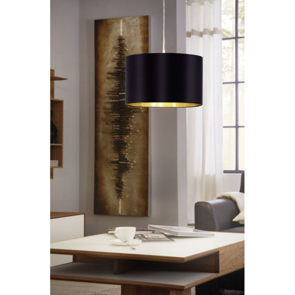 Luxry black & gold pendant light presented in an apartment interior