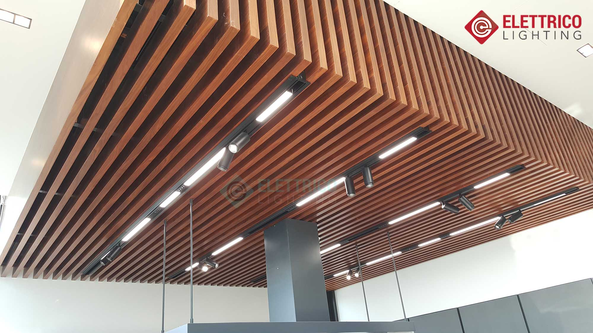 Modern lighting track system installed in wooden ceiling