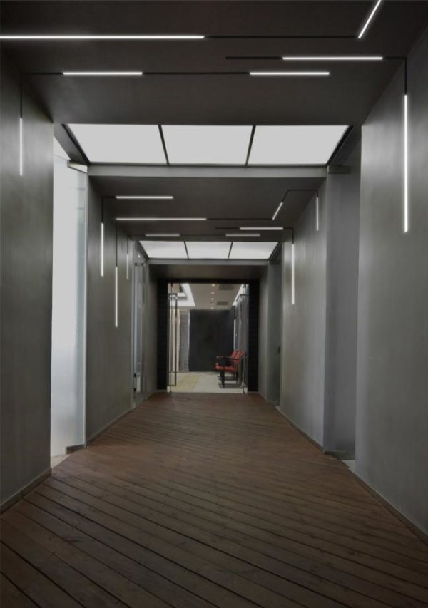 Lighting interior design with linear lights on ceiling and walls